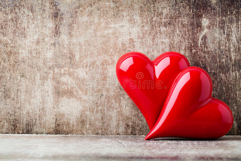 Heart. Red stone hearts on the wood background. stock images