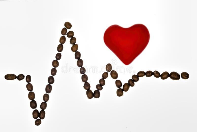 Heart rhythm with coffee beans stock photos