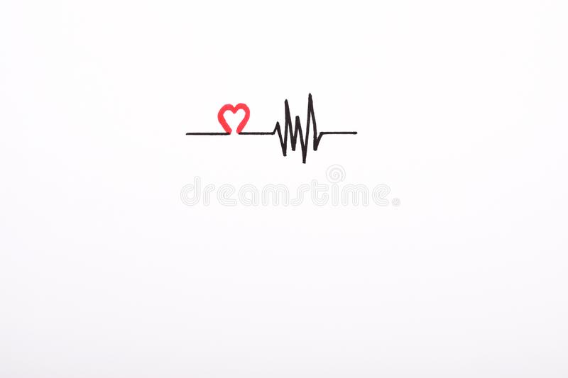 Heart rhythm hand drawing, electrocardiogram, heart beat pulse line concept on white paper stock photos