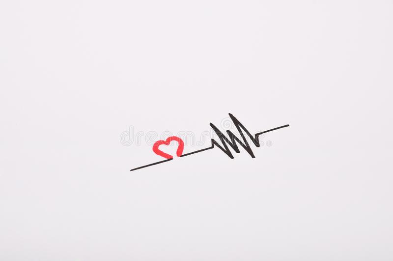 Heart rhythm hand drawing, electrocardiogram, heart beat pulse line concept on white paper stock image