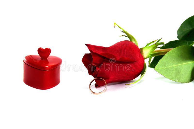 Heart, a ring and red rose royalty free stock photo