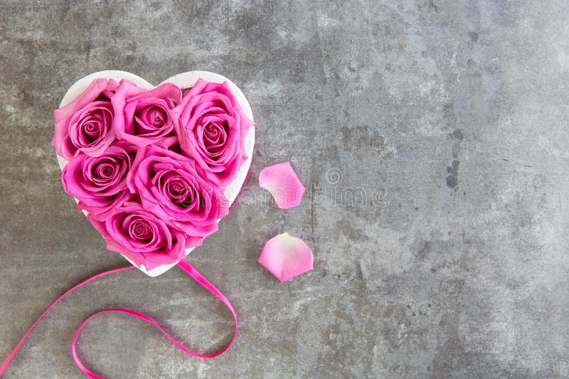 Heart of roses in pink on grey background. Top view, free space for text, Mother`s Day royalty free stock photo