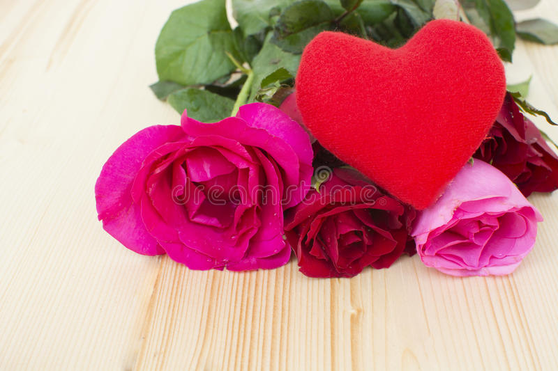 Heart with roses on the wooden.  royalty free stock photos