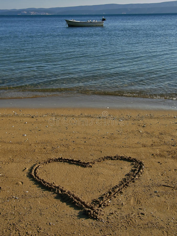 Download Heart In The Sand, Boat At Sea Stock Photo - Image: 23129932