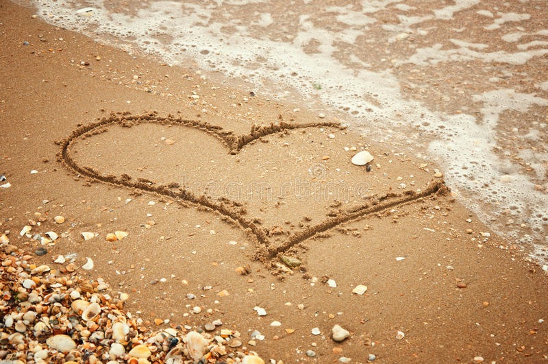 Heart on sand royalty free stock images