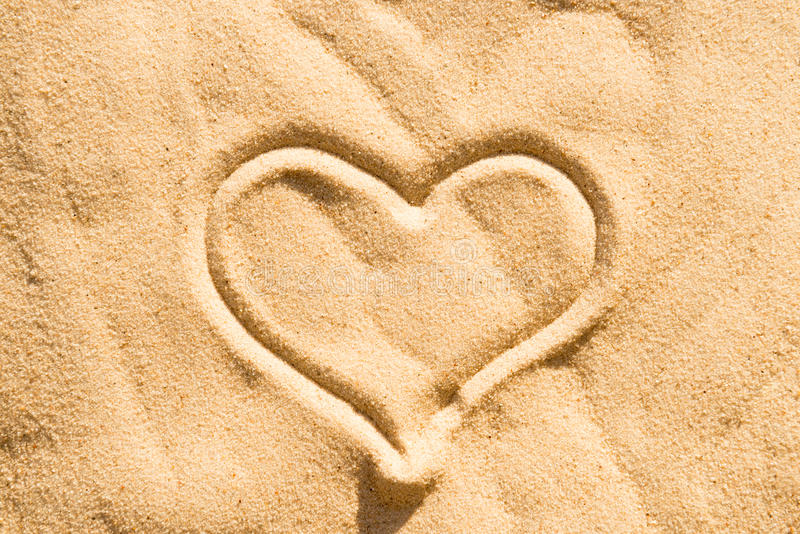 Heart on the sand. Heart sign drawing on the beach sand royalty free stock photography
