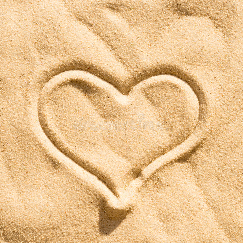 Heart on the sand. Heart sign drawing on the beach sand stock photography