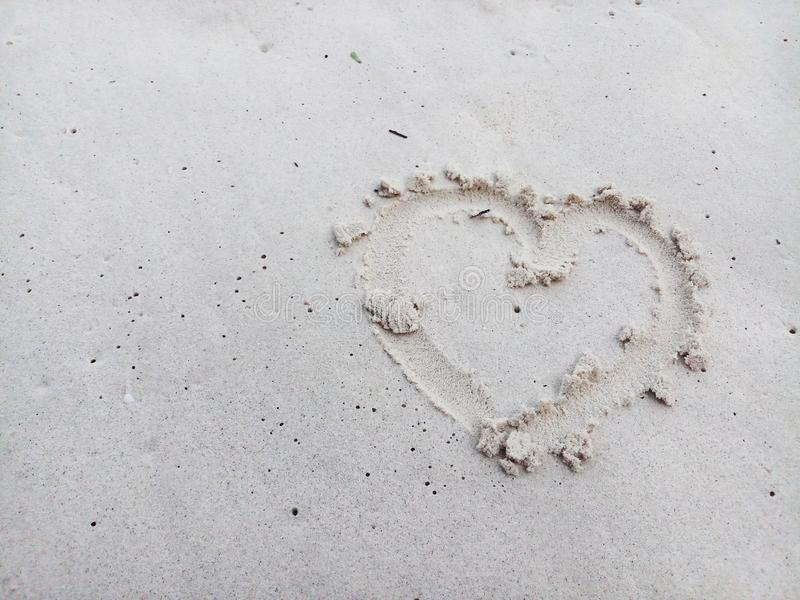 Heart on the sand stock photos