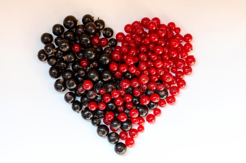Heart shape assorted berry fruits on white background. Black-blue and red food. Mixed berries with copy space for text. Various stock images