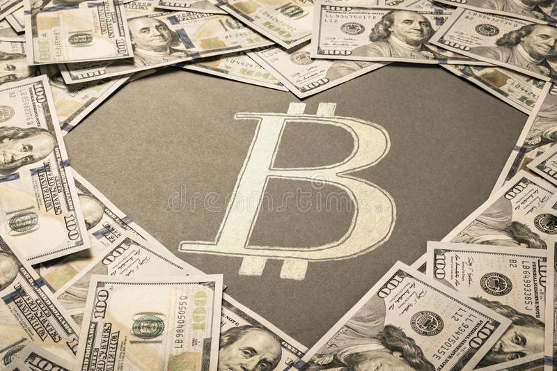 Heart shape and Bitcoin sign in center of dollar background royalty free stock images