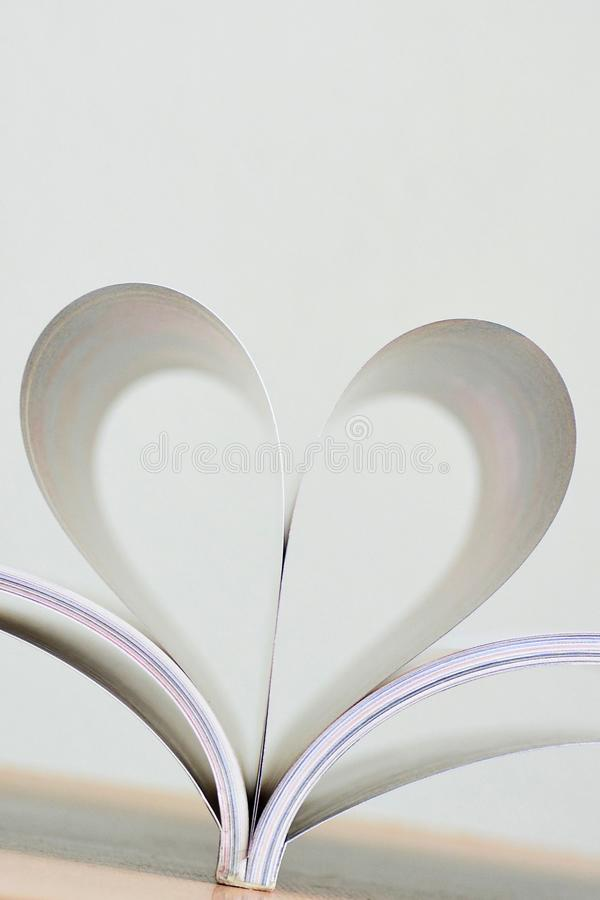 Heart shape of book page. Close up heart shape of book page stock image