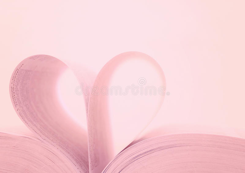 Heart shape book. And pink background royalty free stock photo