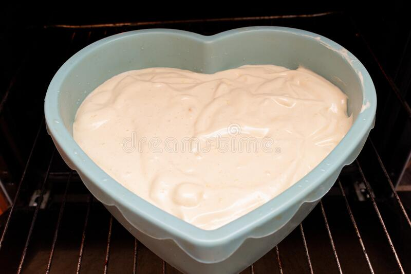 Heart shape cake cooking process. Valentines day gift preparation dating stock images