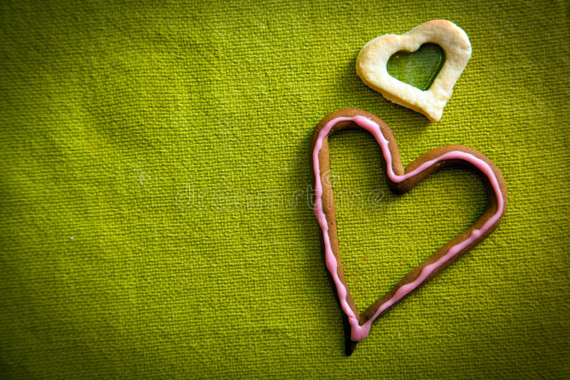 Heart shape candy on green. Background. Ideal for Valentine's Day etc royalty free stock images
