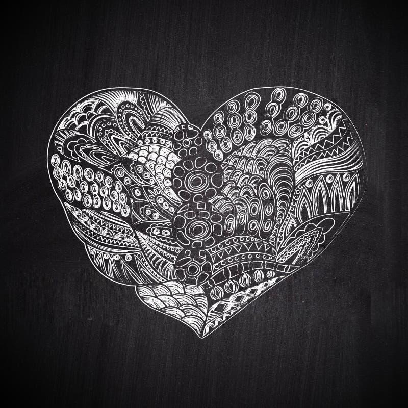 Heart shape chalk drawing on chalkboard blackboard. Doodle Heart stock photo