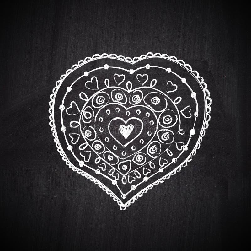 Heart shape chalk drawing on chalkboard blackboard stock images