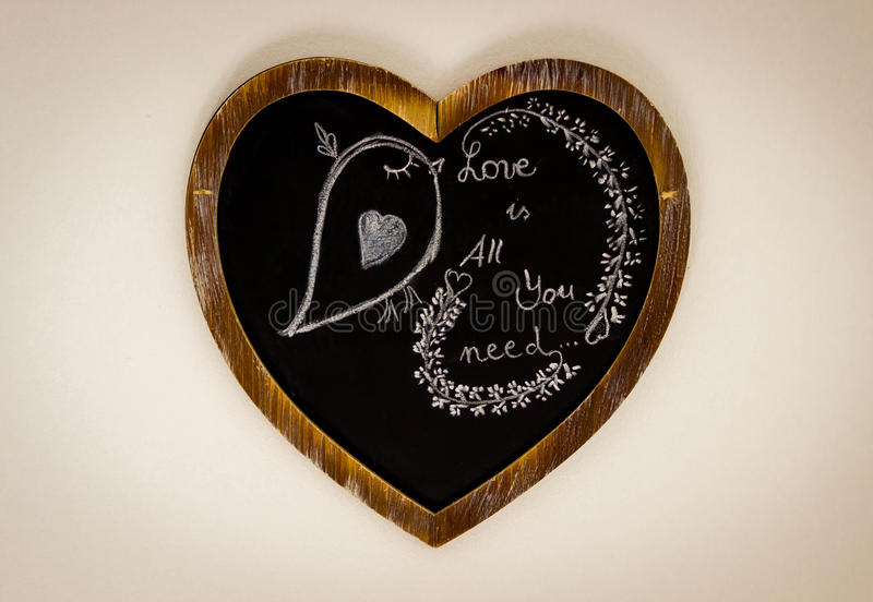 Heart Shape Chalk drawing - Love is all you need royalty free stock photo