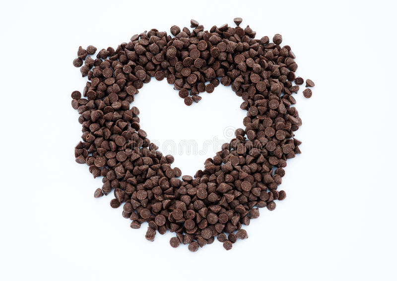 Heart shape of chocolate chips stock images