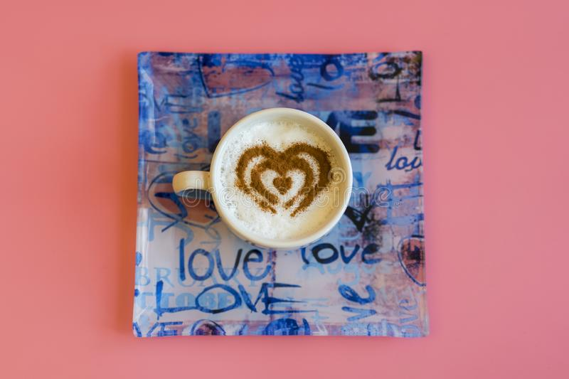 Heart Shape Coffee Cup Concept isolated on pink background. love cup , heart drawing on latte art coffee stock images