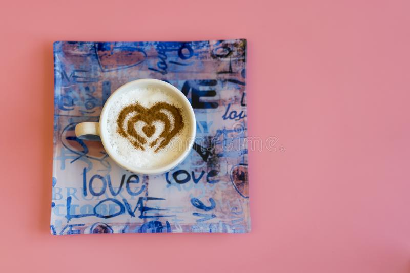 Heart Shape Coffee Cup Concept isolated on pink background. love cup , heart drawing on latte art coffee. copy space stock images