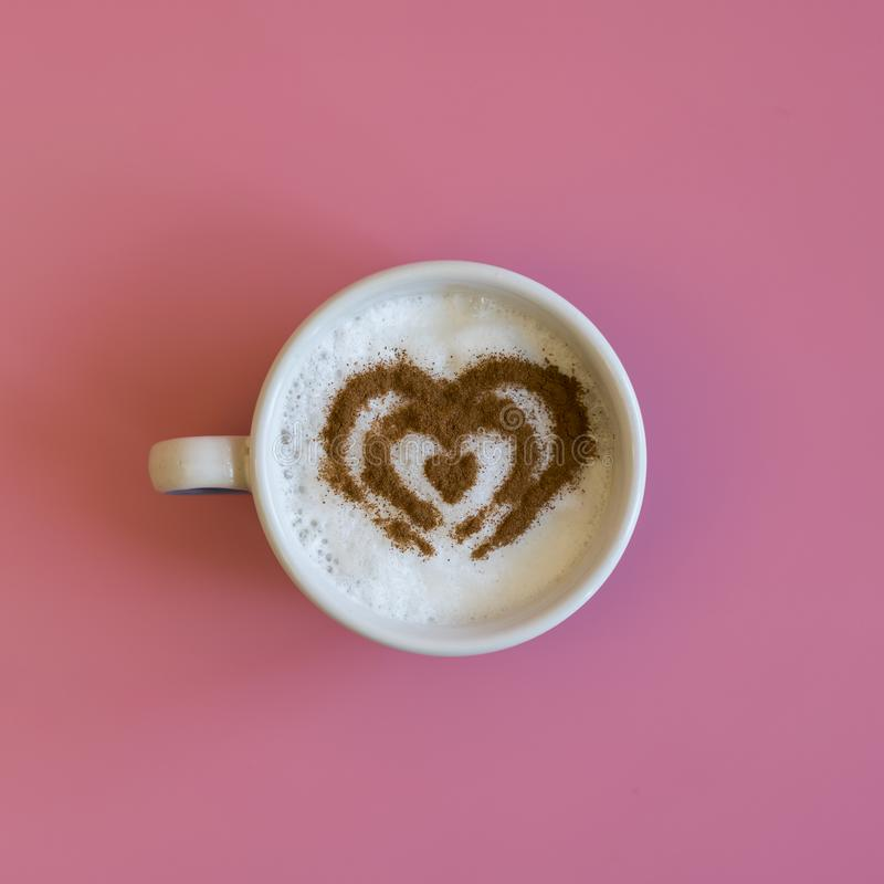 Heart Shape Coffee Cup Concept isolated on pink background. love cup , heart drawing on latte art coffee. square royalty free stock images