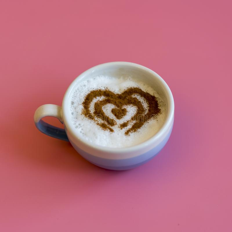Heart Shape Coffee Cup Concept isolated on pink background. love cup , heart drawing on latte art coffee. square royalty free stock image