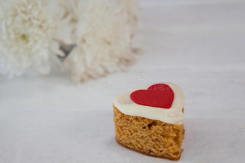 Heart shape easter gingerbread cookie on white table stock photos