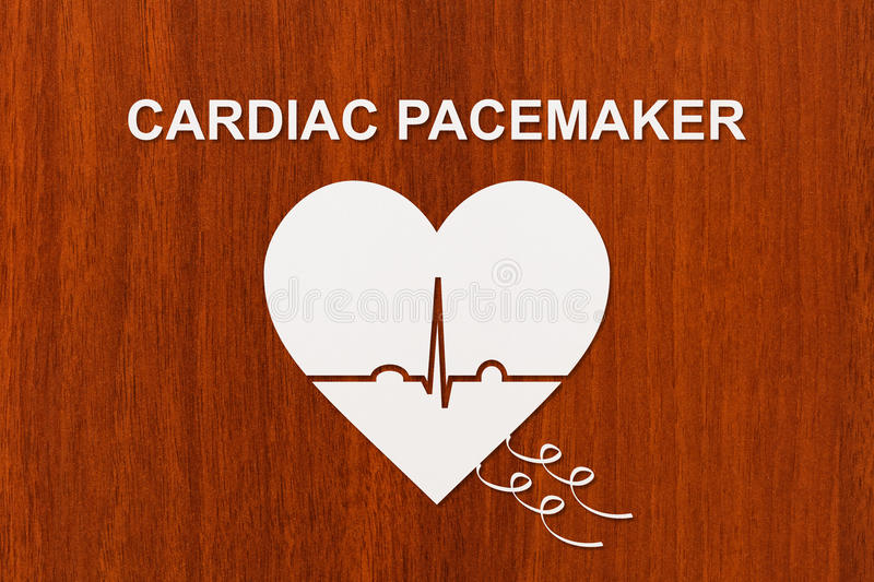 Heart shape with echocardiogram and CARDIAC PACEMAKER text. Cardiology concept. Heart shape with echocardiogram and CARDIAC PACEMAKER text. Medical cardiology royalty free stock images