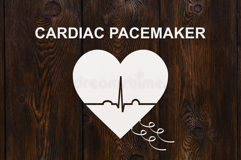 Heart shape with echocardiogram and CARDIAC PACEMAKER text. Cardiology concept. Heart shape with echocardiogram and CARDIAC PACEMAKER text. Medical cardiology stock image