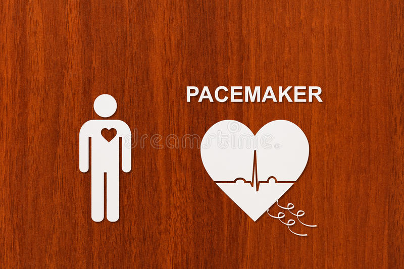Heart shape with echocardiogram and PACEMAKER text. Cardiology concept. Man and heart shape with echocardiogram and PACEMAKER text. Medical cardiology concept royalty free stock photography