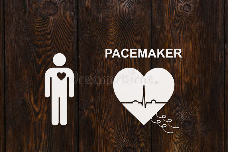 Heart shape with echocardiogram and PACEMAKER text. Cardiology concept. Man and heart shape with echocardiogram and PACEMAKER text. Medical cardiology concept stock image