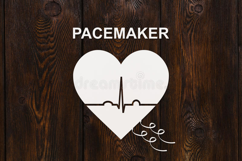Heart shape with echocardiogram and PACEMAKER text. Cardiology concept. Heart shape with echocardiogram and PACEMAKER text. Medical cardiology concept royalty free stock photo