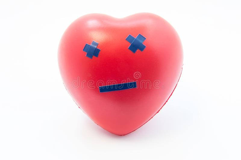 Heart shape with emotion dead smile. Concept photo visualizing death, broken heart of love, failure, cardiac arrest, myocardial in stock photo