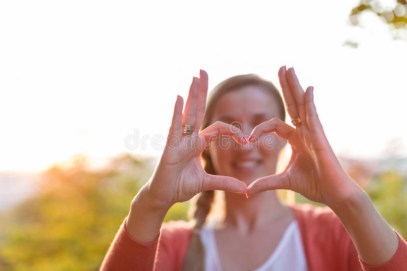 Heart shape with fingers and thumb