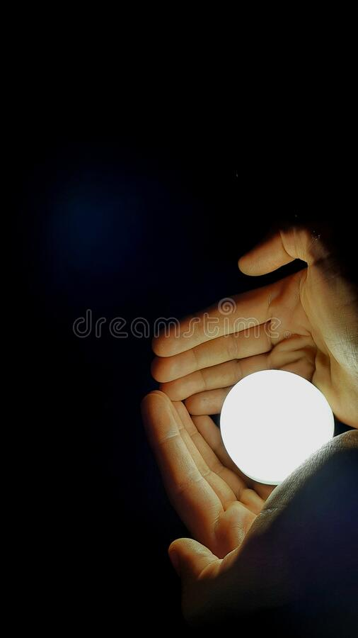 Heart shape hands with crystal ball stock photos images. Background royalty free stock images