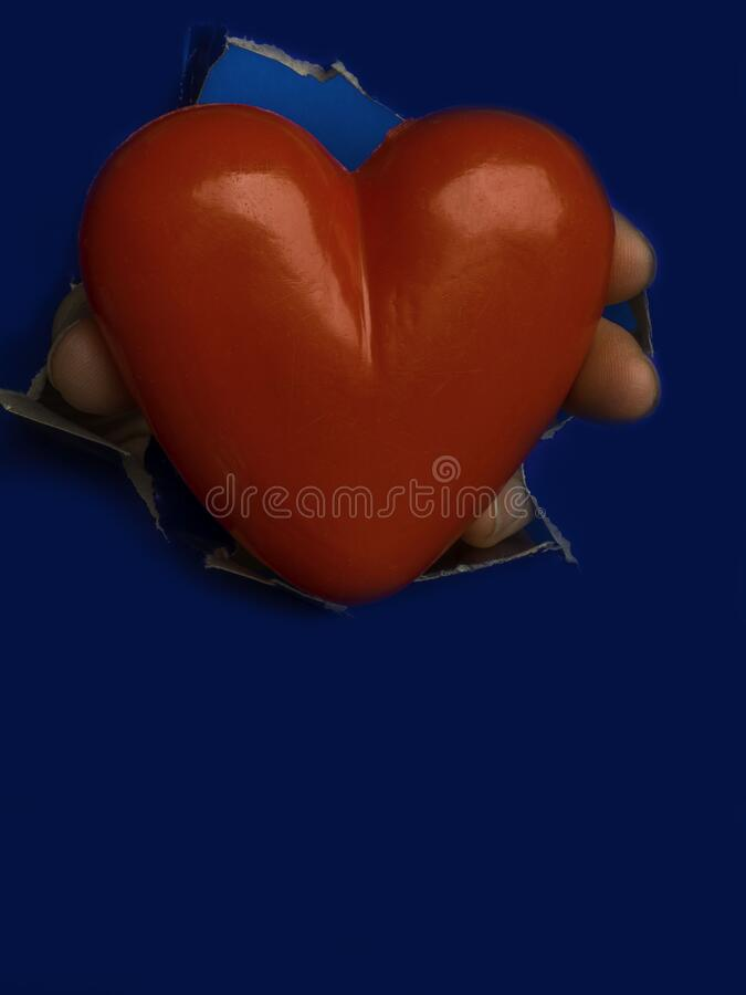 Heart shape hole through blue paper, with space for text. Valentine Heart Card Design stock image