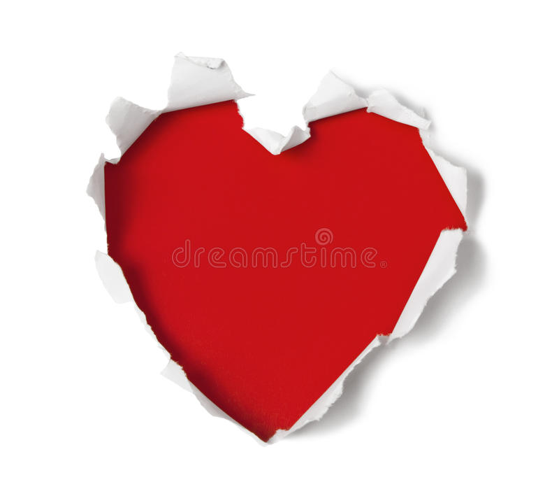 Heart shape hole through paper royalty free stock photography