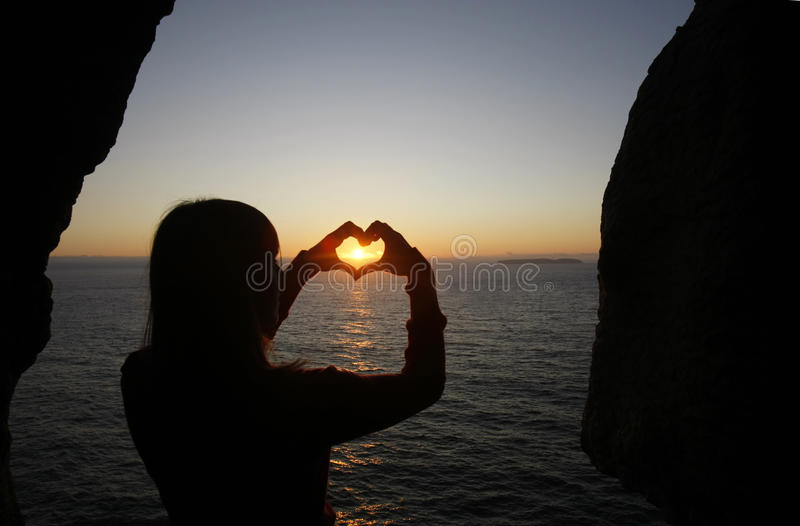 Heart shape made with a girl hands royalty free stock photos