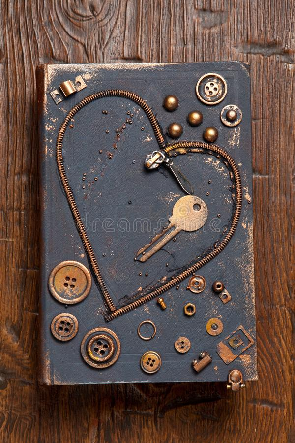 Heart shape made of metal zipper, key, buttons and other garbage. royalty free stock photos