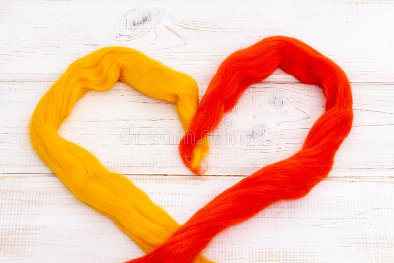 Heart shape made of multi-colored wool stock images