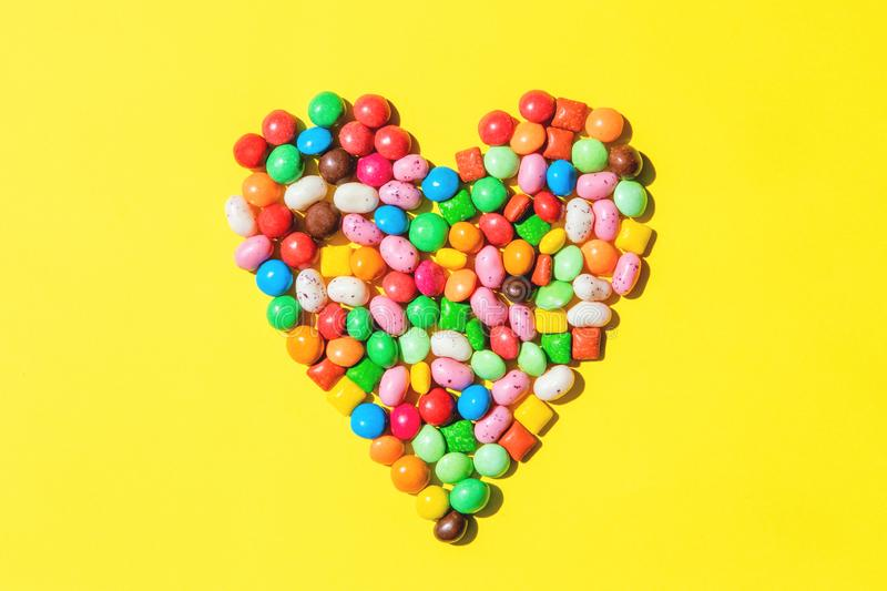 Heart shape made of small colorfull candies royalty free stock image