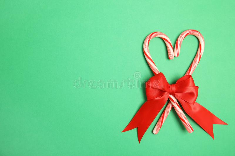 Heart shape made of tasty candy canes with bow royalty free stock photo