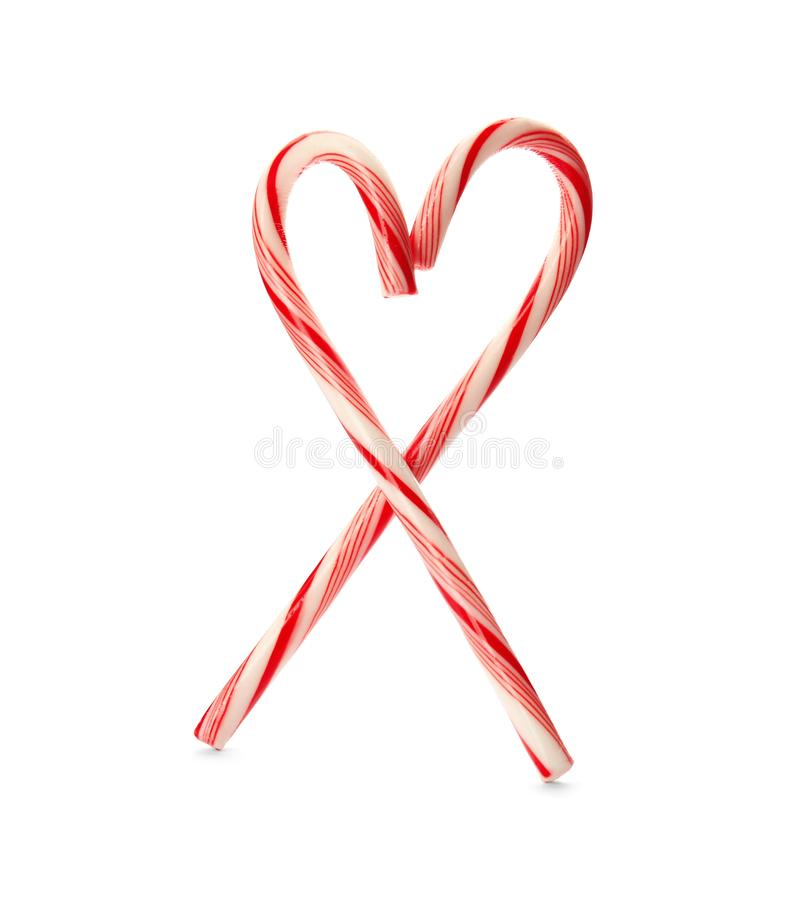 Heart shape made of tasty candy canes. On white background. Festive treat royalty free stock photo