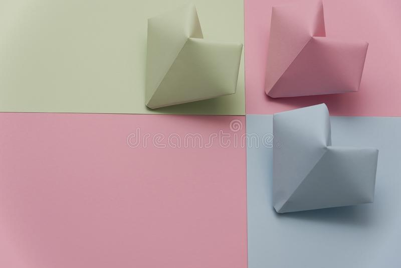 Heart shape made of torn pieces of colorful paper isolated over the origami paper hearts royalty free stock photos