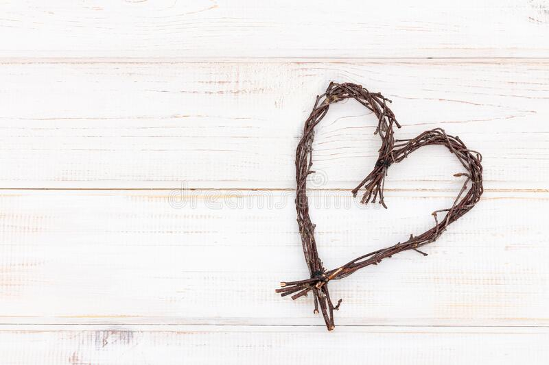 Heart shape made of twigs - wooden symbol of love on a white background royalty free stock photos