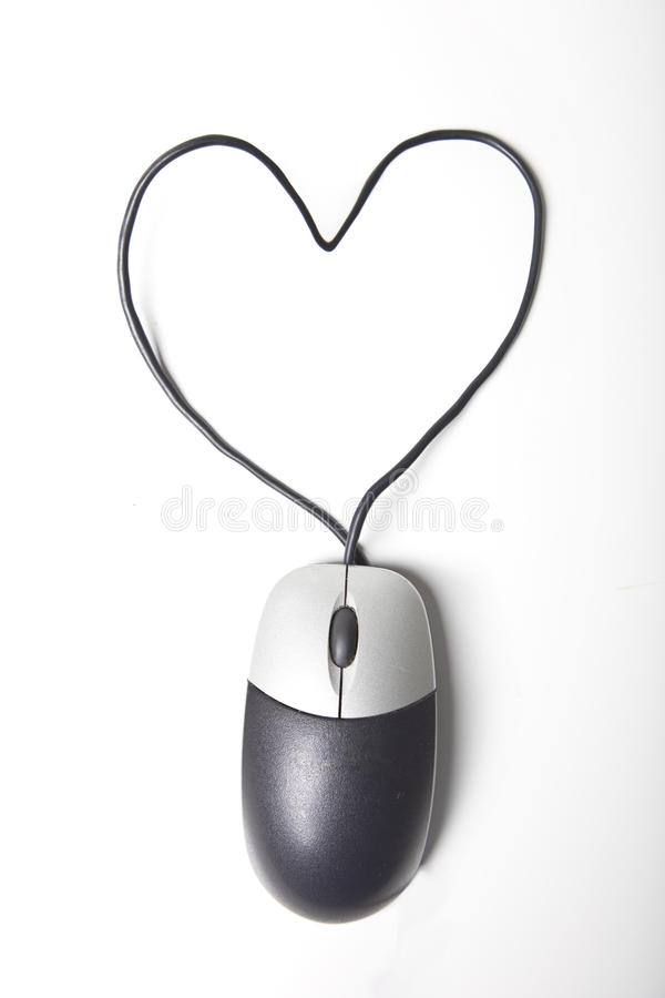 Heart shape made up of computer mouse wire over white background royalty free stock photo