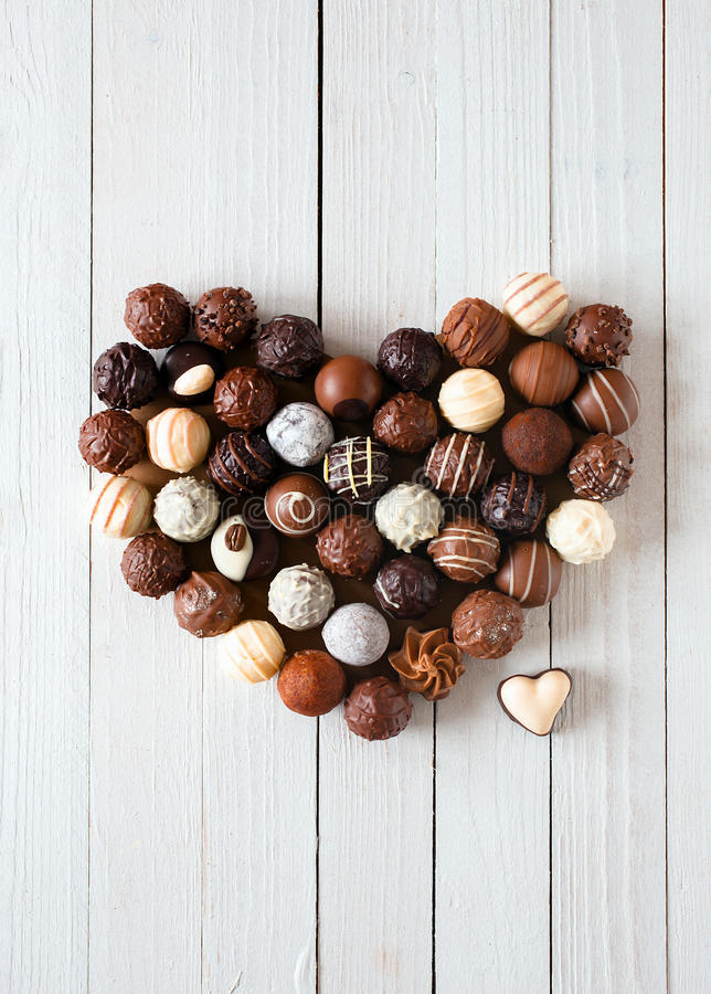 Heart shape made with various chocolate truffles royalty free stock photos