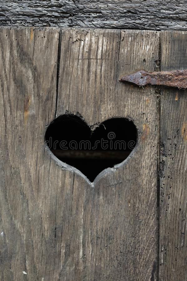 Heart shape on an old door stock images