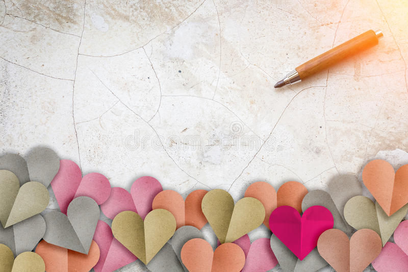 Heart shape paper cut with pastel color and wooden penci. L on wood background with copy-space for your ideas royalty free stock photography