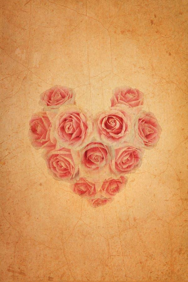 Heart shape pink rose on old brown grunge paper. Background stock illustration
